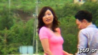 Young asian babe flashes her juicy milk cans in public