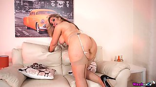 Big bottomed milf Kellie O Brian is stripping and showing off her jugs and booty