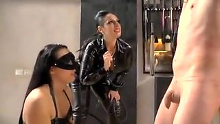Cruel Mistresses with friend whips a naked slave