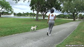 diamond kitty is walking with her dog and flashing her giant glutes