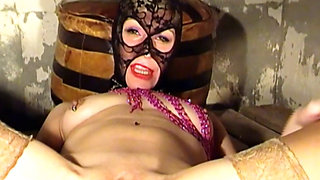 Hot slut in a gimp mask fucks a huge dildo