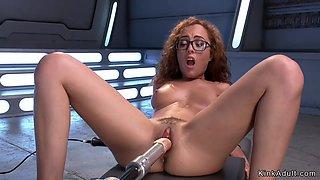 Ginger in eyeglasses banging machine